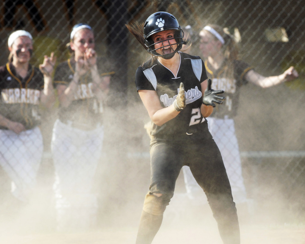 Alyssa Natale of Bridgewater scores in extra innings during the  Bridgewater-Raritan versus Watchung Hills girls softball Somerset County Tournament game won by Bridgewater-Raritan 5-2,  in Warren.