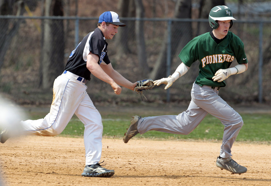Brandon Bollin of Middlesex tags out Dean Bogdanovic of New Providence during the Middlesex versus New Providence boys high school baseball game  during the Roselle Park Dad's Club tournament  in Roselle Park.