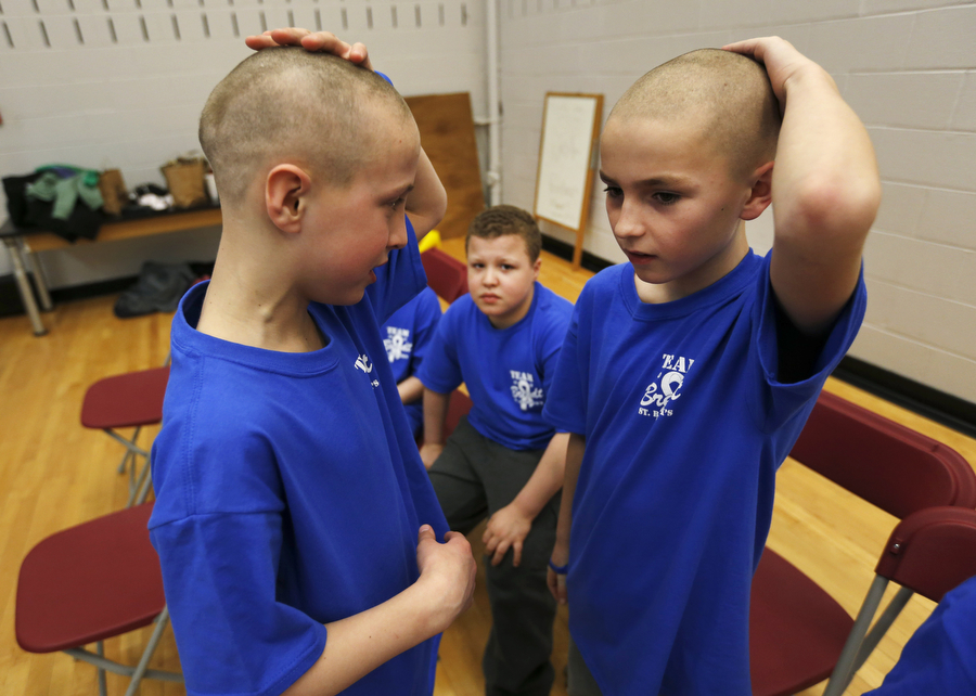 Shaving their heads for charity